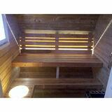 Ovale Sauna mit Ankleideraum und vorderer Terrasse